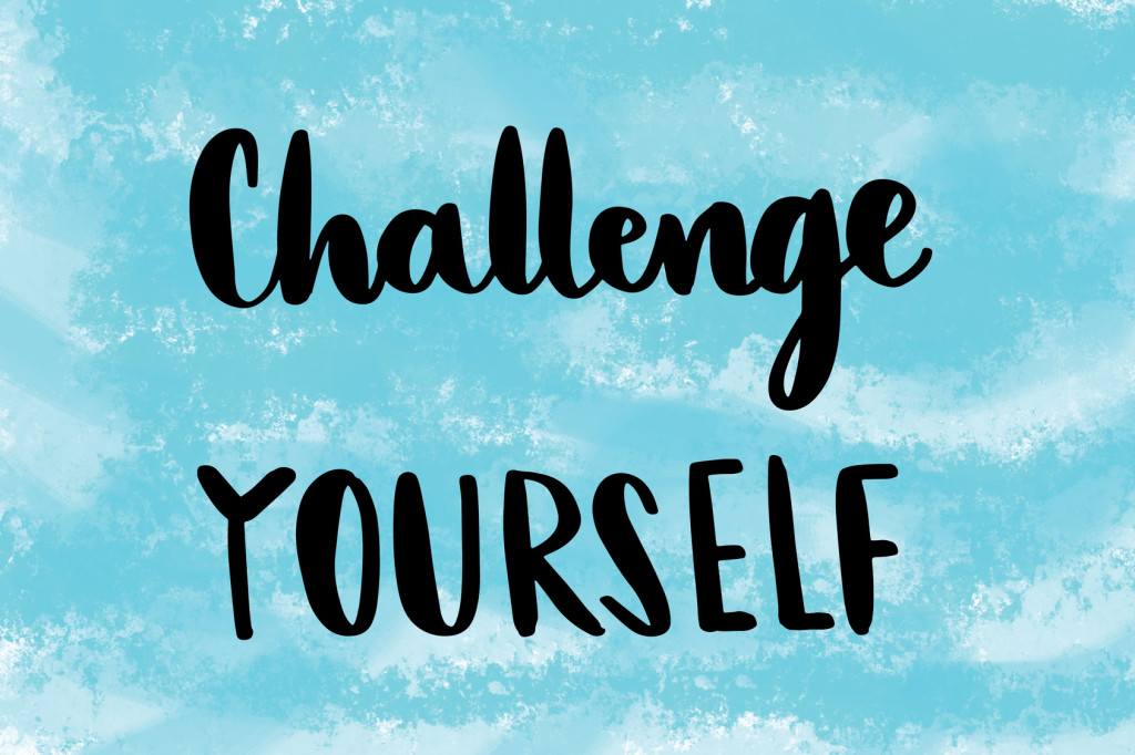 Challenge yourself motivational message over blue painted background
