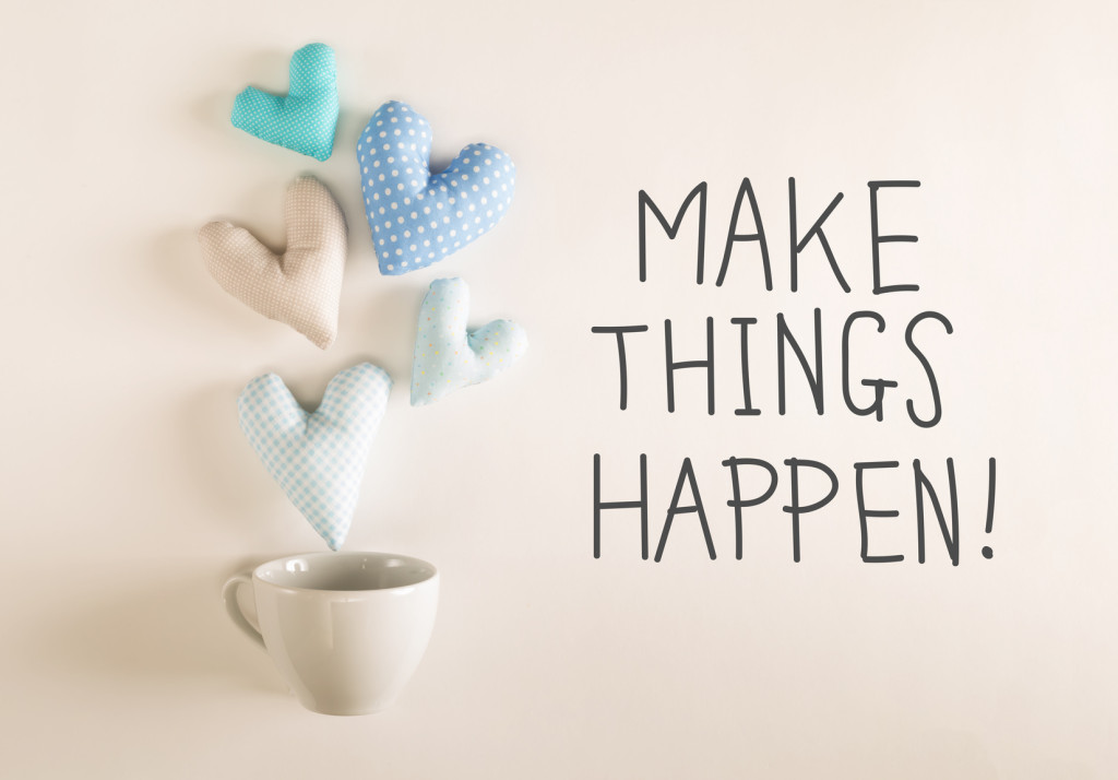 Make Things Happen message with blue heart cushions coming out of a coffee cup