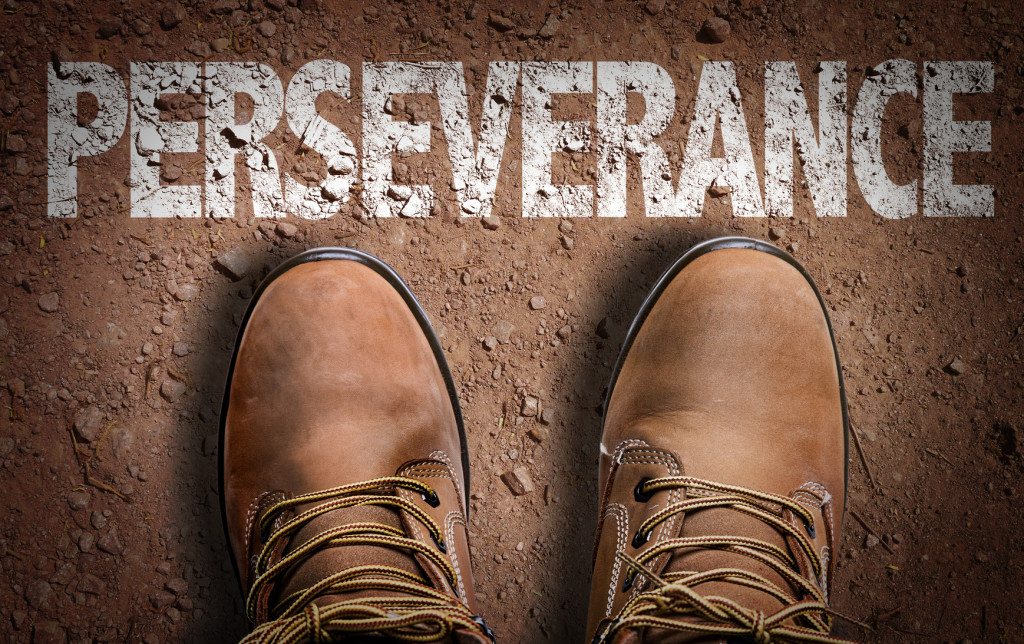 Top View of Boot on the trail with the text: Perseverance