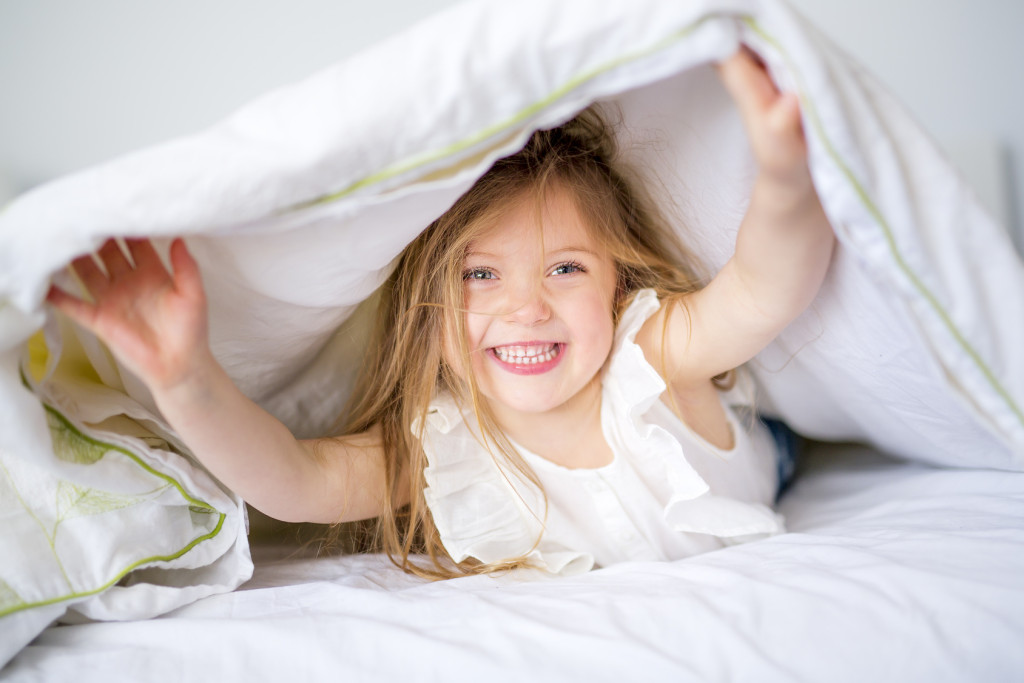 An Adorable little girl waked up in her bed