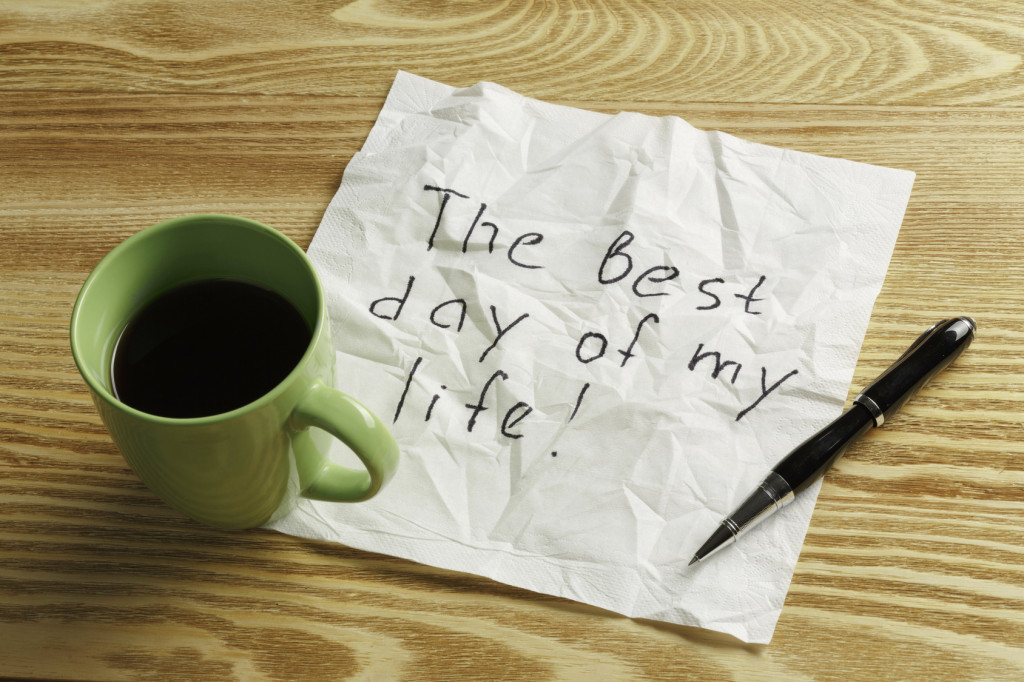 Coffee cup pen and napking with message on wooden table